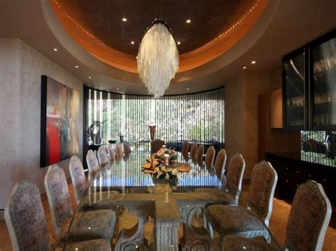 Large Luxury Dining Room With Glass Table and Crystal